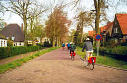 Biking through a village, Holland